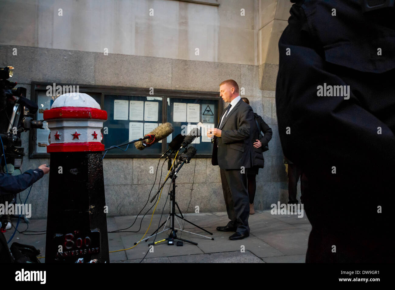 Detective Inspector Pete Sparks reads out a short statement from Lee Rigby's family to the press after the sentence was given. - Stock Image