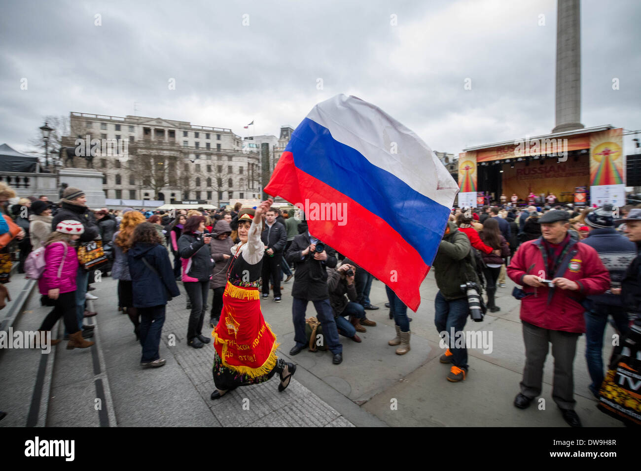 Spectator with flag of Russia in the crowd for Russian Maslenitsa Festival 2014, Trafalgar Square, London, UK. - Stock Image