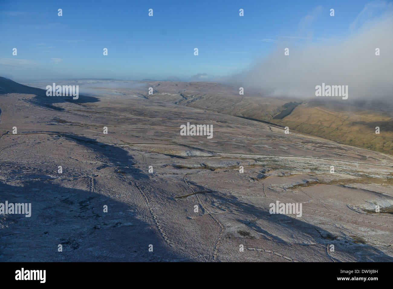 Aerial Photograph showing snow-dusted hilltops in the Yorkshire Dales, North Yorkshire on a sunny Winter's day - Stock Image