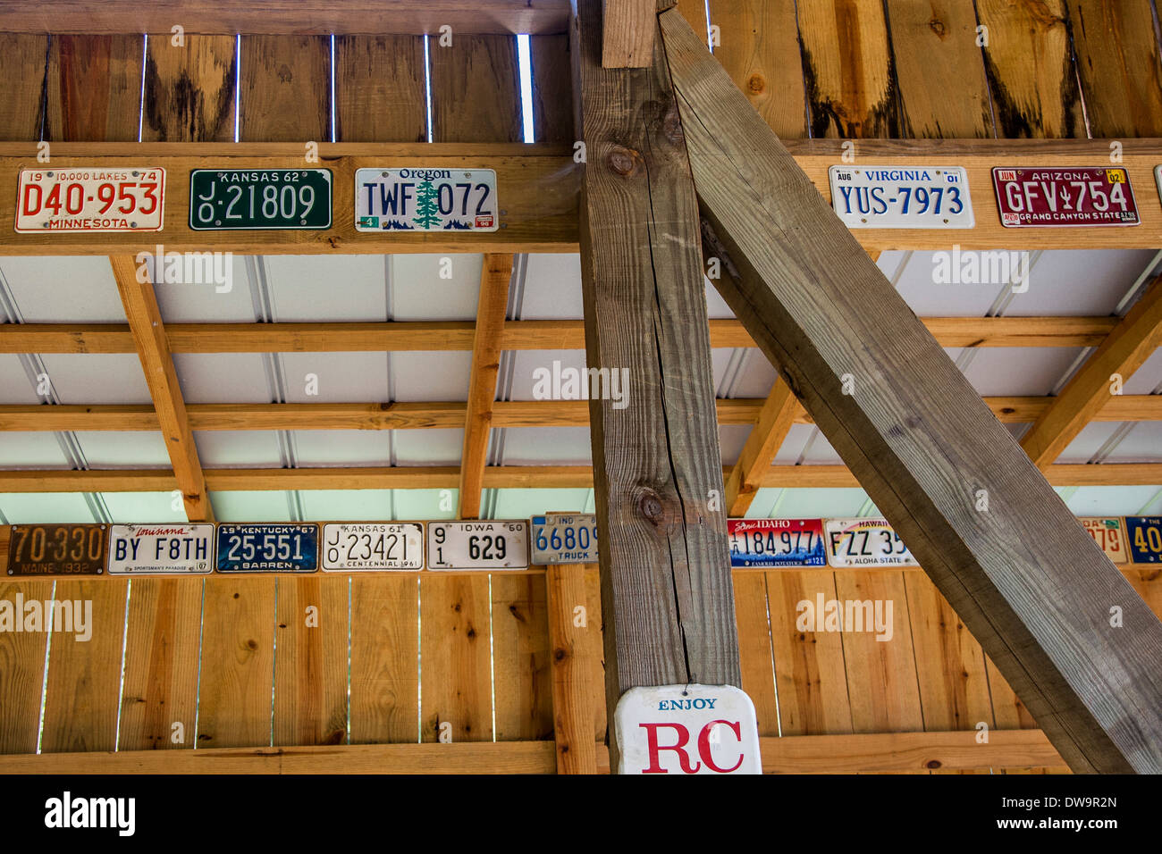 License plates from all 50 states decorate a privately owned covered bridge outside of Elberta, Alabama - Stock Image
