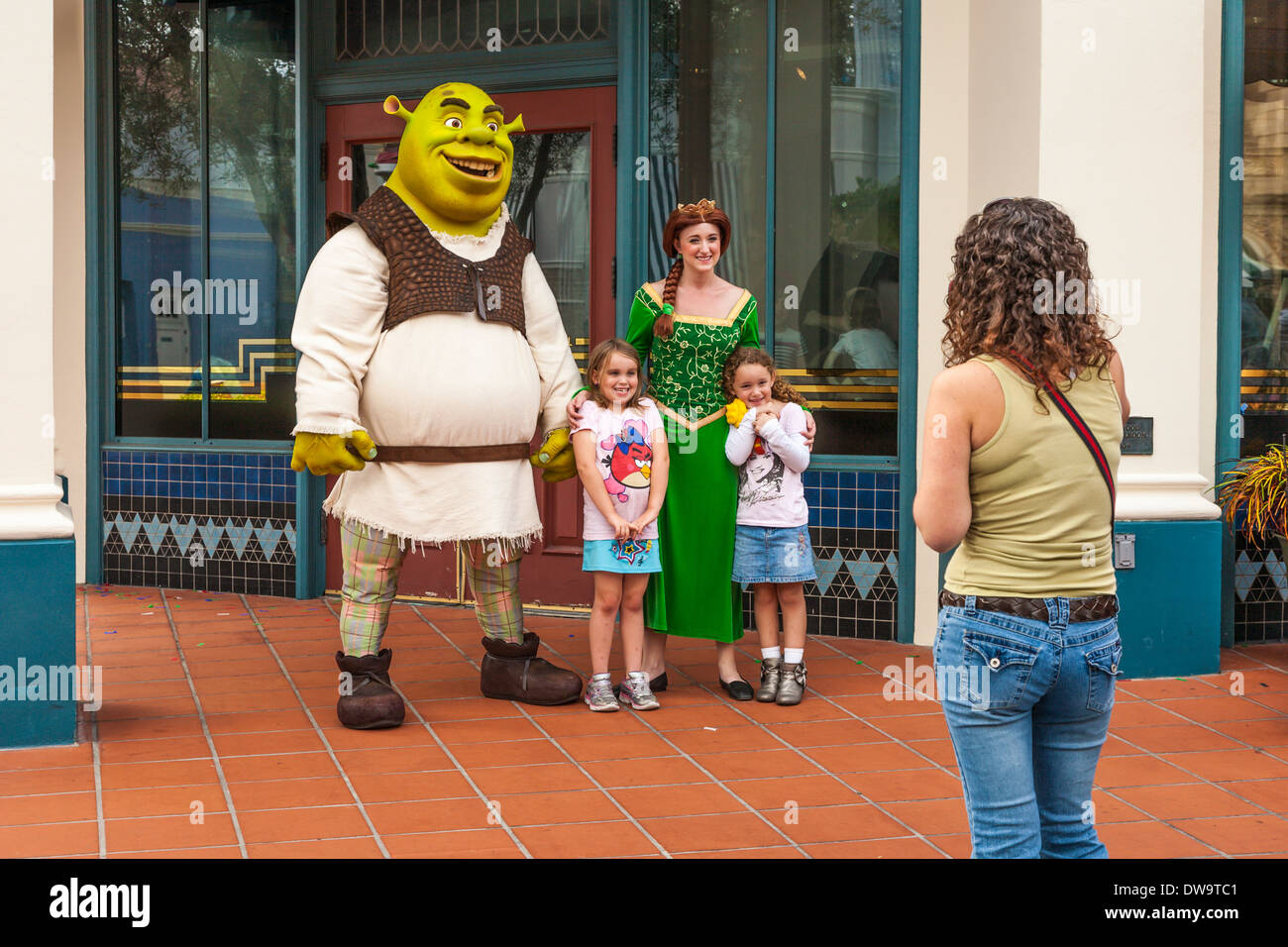 Woman Photographing Daughters With Shrek And Princess Fiona At Stock Photo Alamy