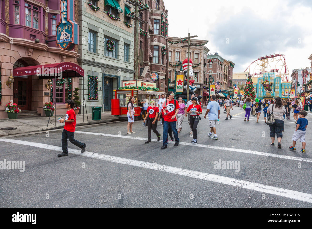 Family wearing Thing T-shirts on the street at Universal Studios theme park in Orlando, Florida - Stock Image