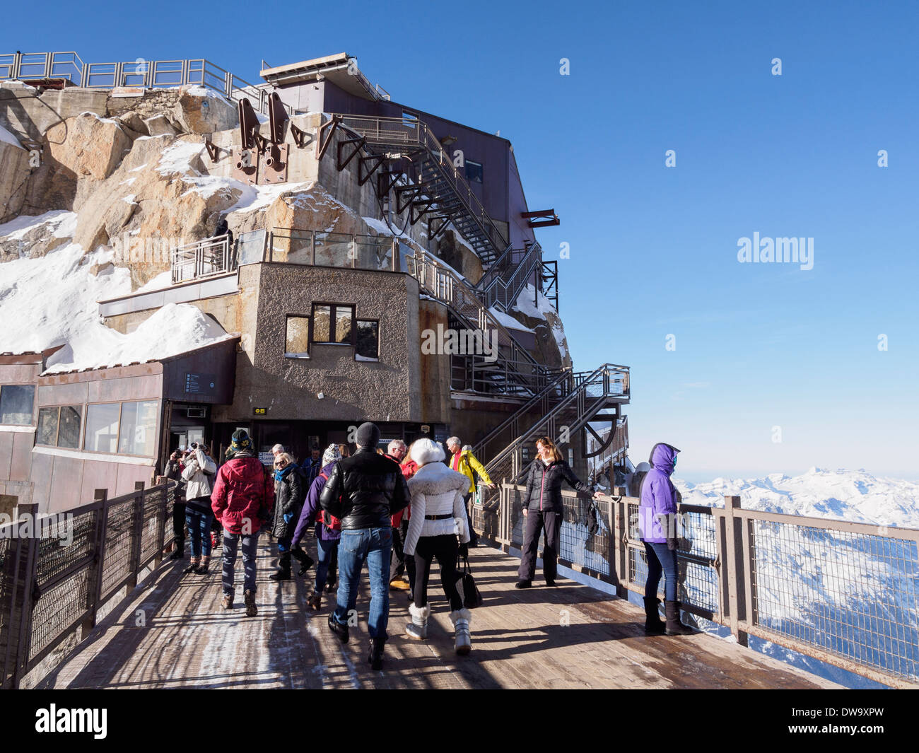 People on bridge viewing platform at Aiguille du Midi top téléphérique cable car station. Chamonix-Mont-Blanc Rhone-Alpes France - Stock Image