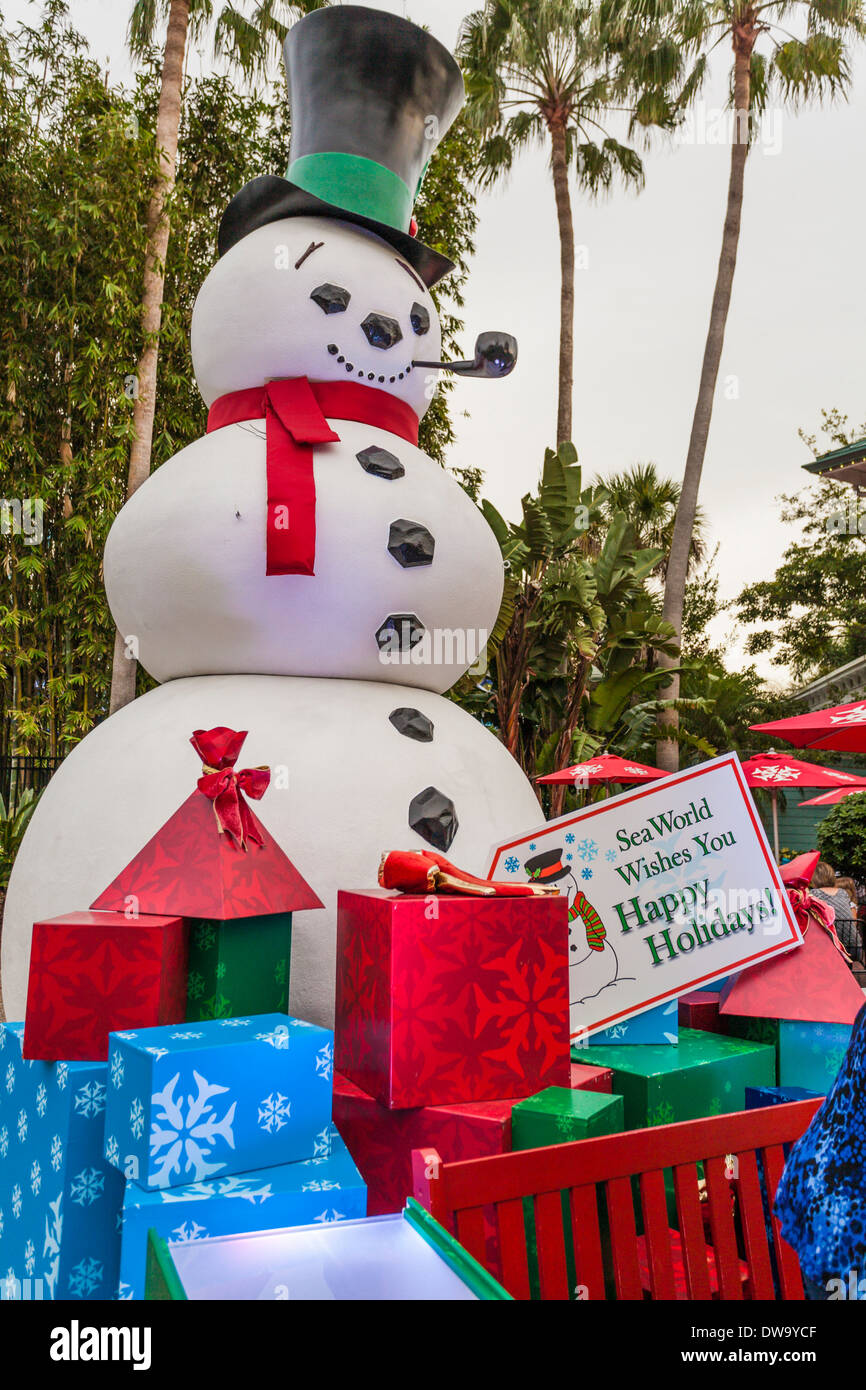 Large snowman surrounded by Christmas presents in SeaWorld, Orlando during the Christmas holiday season Stock Photo
