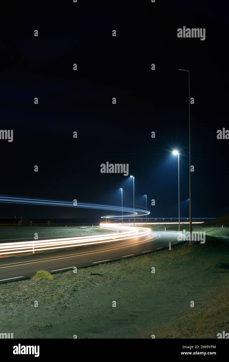 Night time shot of new road built on land reclaimed from sea, Rotterdam harbor, Massvlakte, Rotterdam, Netherlands Stock Photo