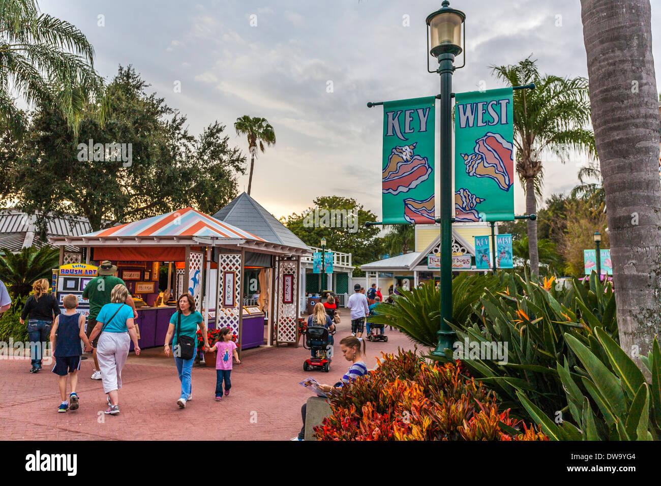 Families walk through the Key West area of SeaWorld, Orlando - Stock Image