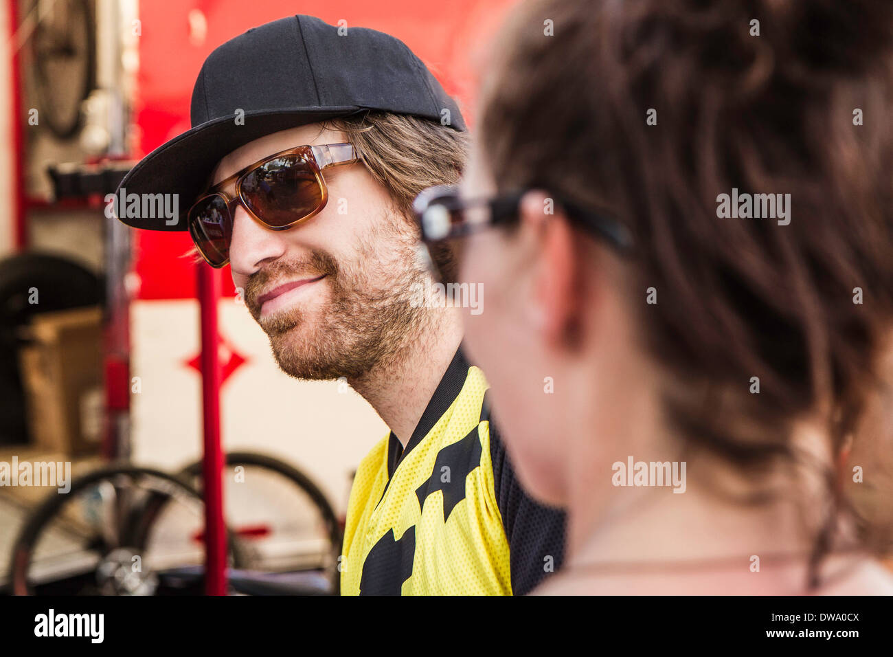 Two mountain bikers taking a break - Stock Image