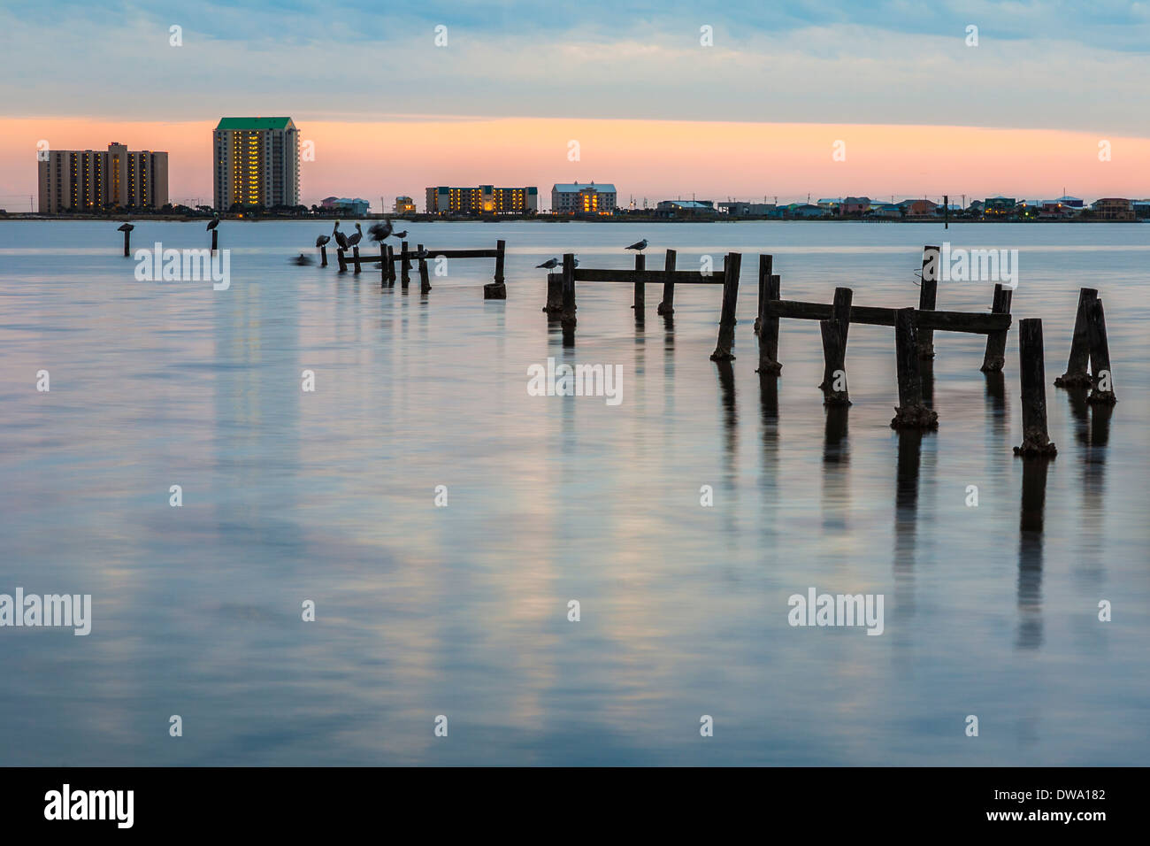 Dilapidated pier extends into the Santa Rosa Sound at Navarre, Florida Stock Photo