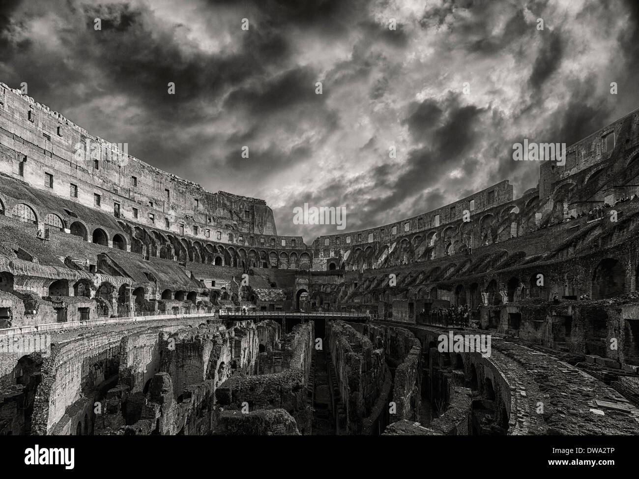 A monochromatic view of the impressive ancient roman colosseum situated in the Italien capital of Rome. - Stock Image