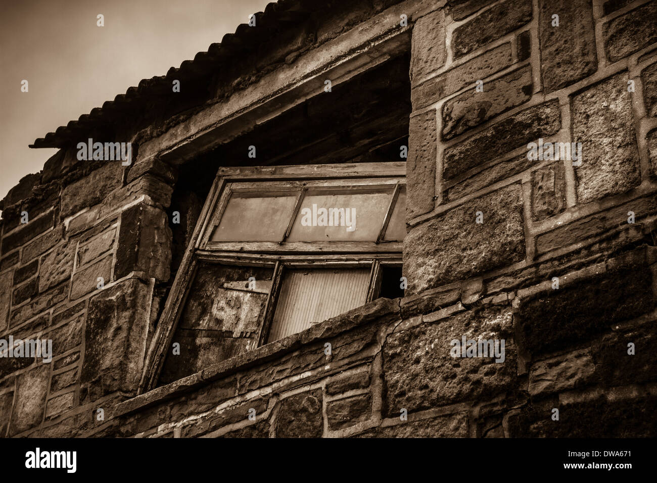Derelict window in a stone farm building - Stock Image