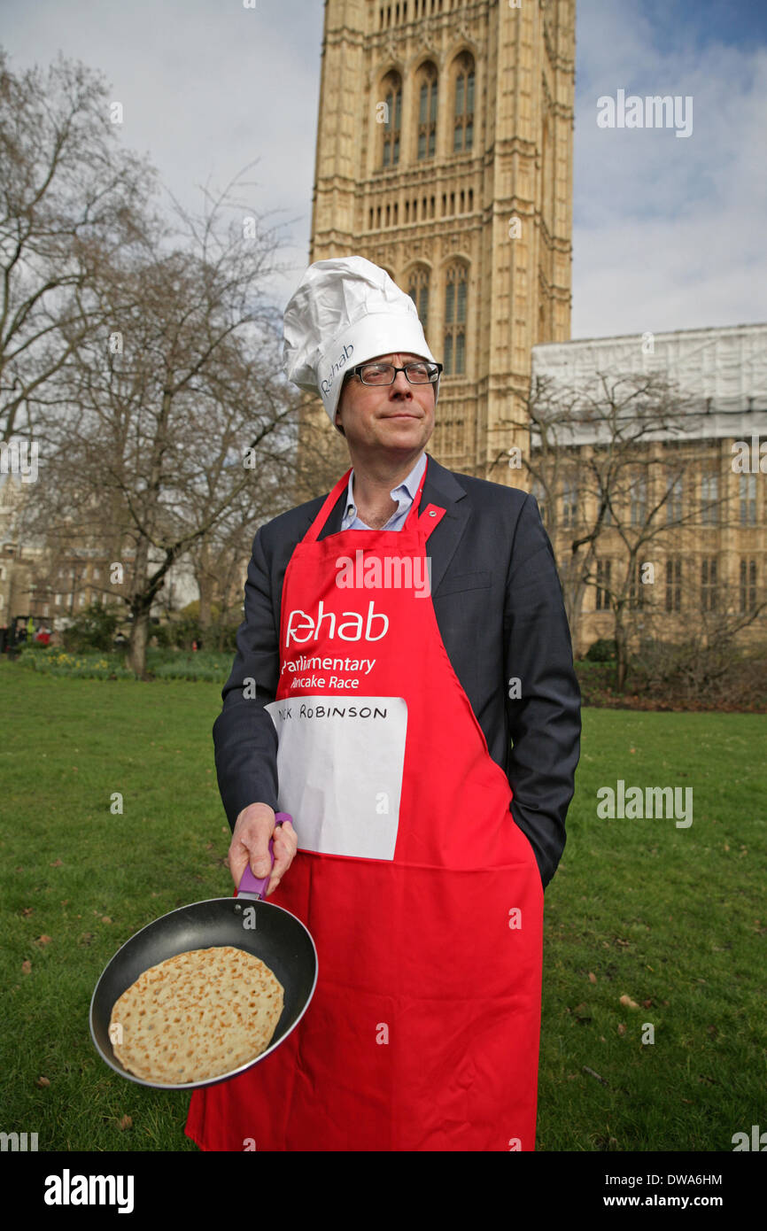 London,UK. 4th March 2014. Nick Robinson at the Parliamentary Pancake Race. Credit: Keith Larby/Alamy Live News - Stock Image