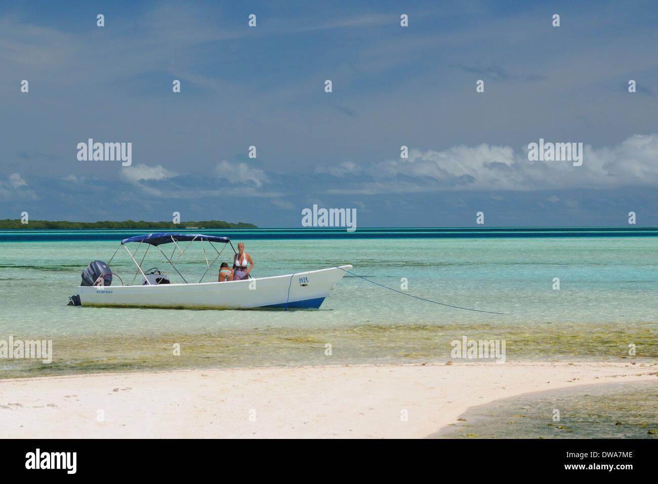 tourist on the boat in to the beach of the Sebastopol reserve , Sebastopol island, Archipelago Los Roques National Park, Venezuela - Stock Image