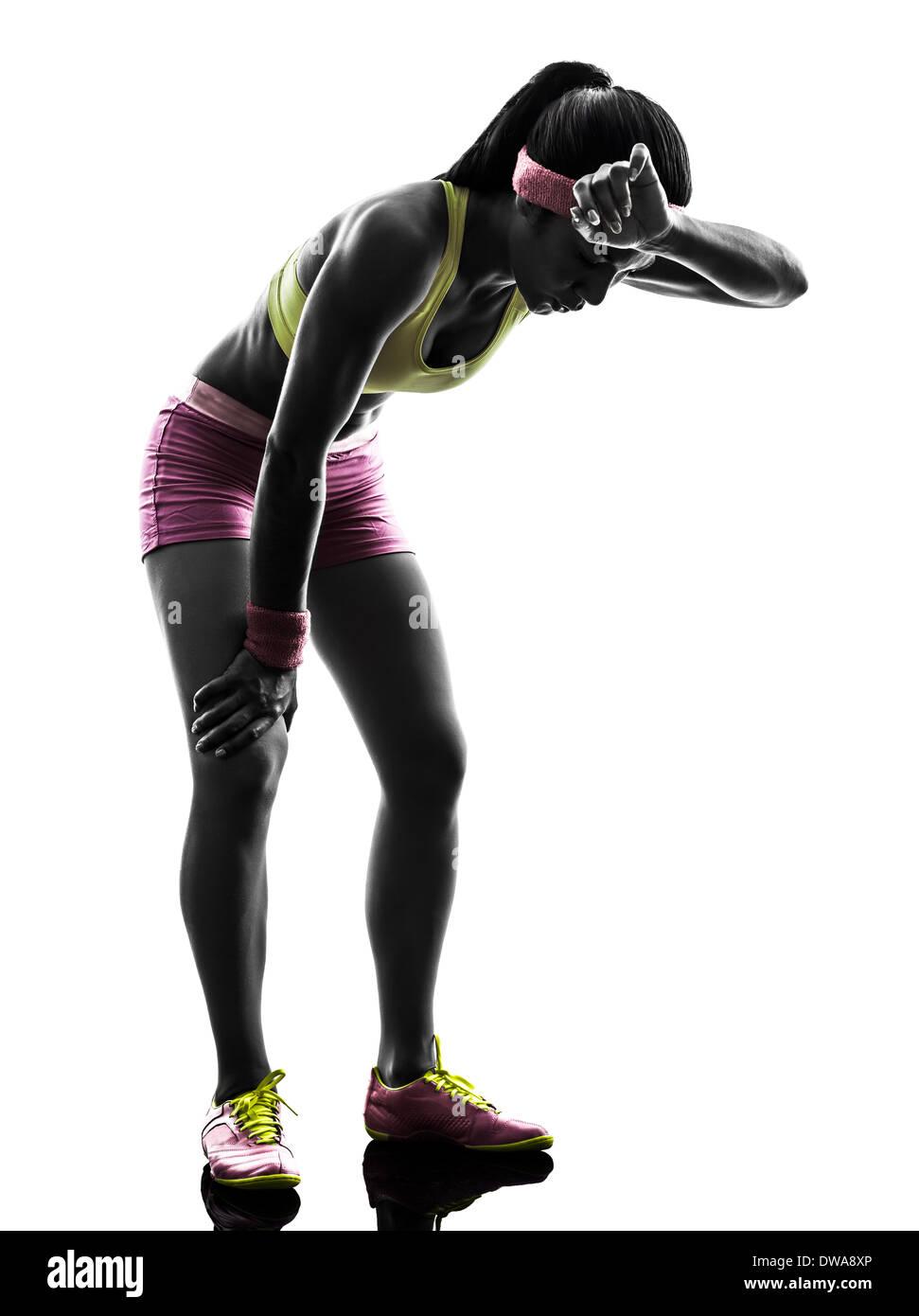 one  woman runner running tired breathless in silhouette on white background - Stock Image