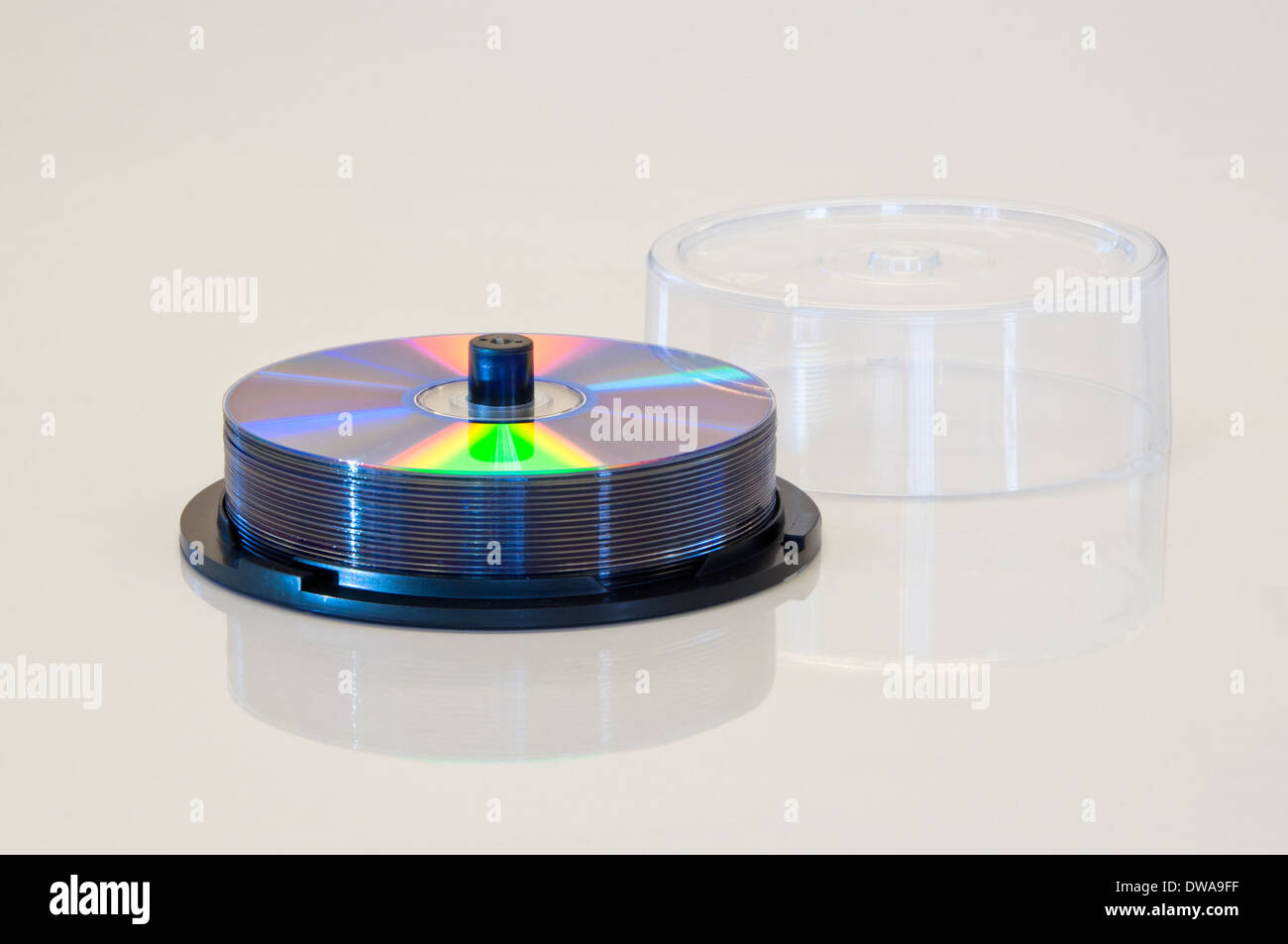 Spindle of DVD or CD discs with clear lid off - Stock Image