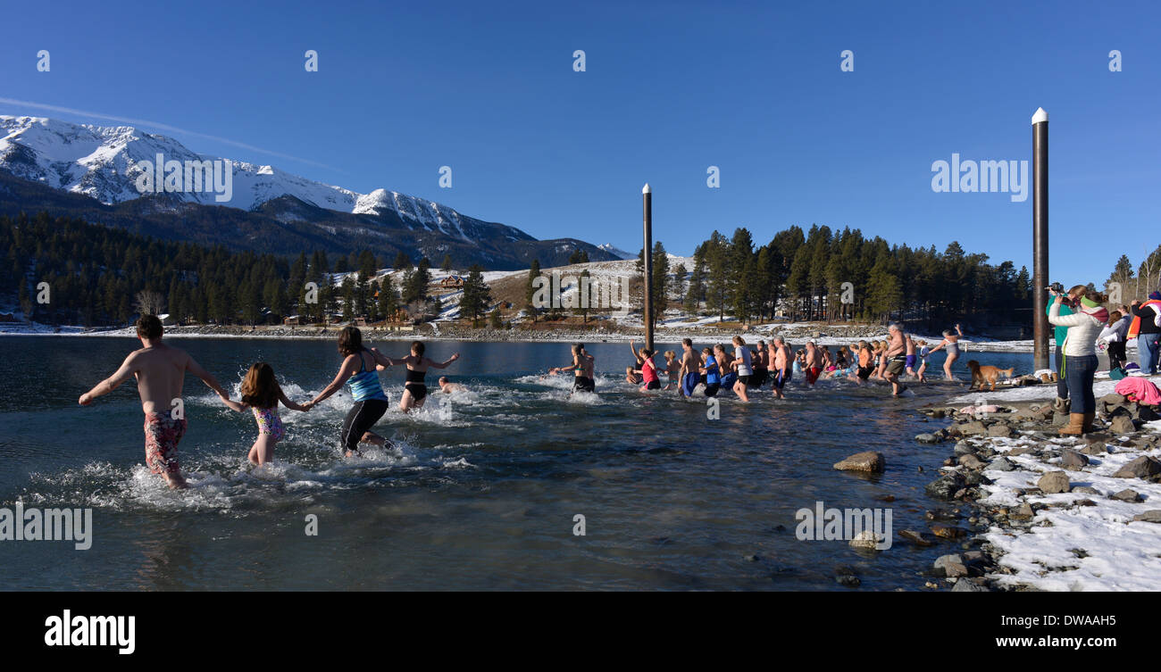 The annual New Year's plunge into Wallowa Lake, Oregon. - Stock Image