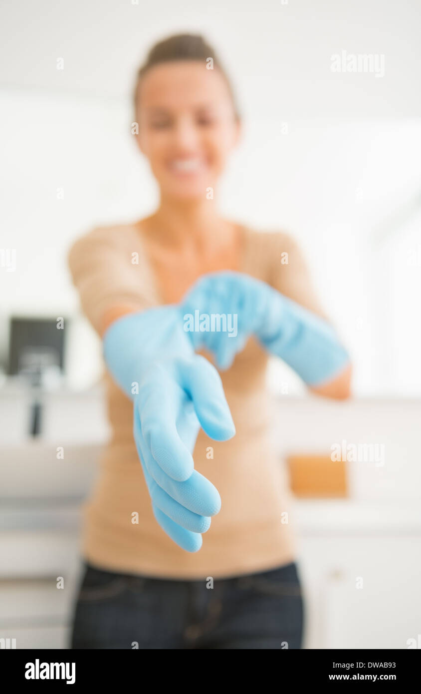 Closeup on housewife wearing gloves - Stock Image