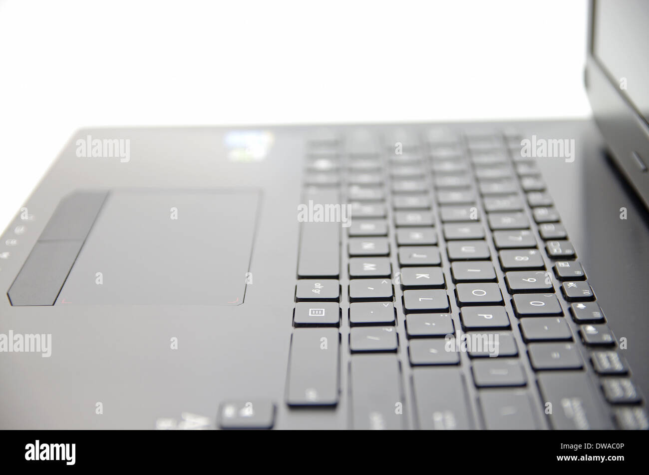 Black laptop keyboard and touchpad surface - Stock Image