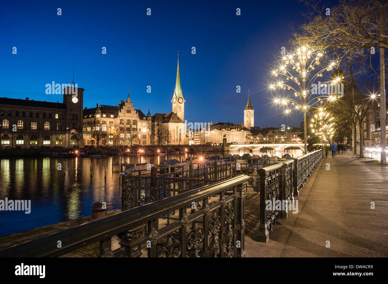 River Limmat, Town Hall, Fraumunster, St. Peters Church, Christmas Illumination, Zurich, Switzerland - Stock Image