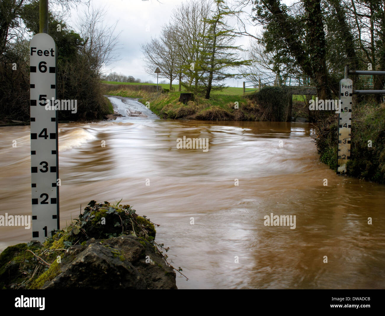 Flooded ford crossing the River Rea, Neen Savage, Shropshire, England, UK - Stock Image