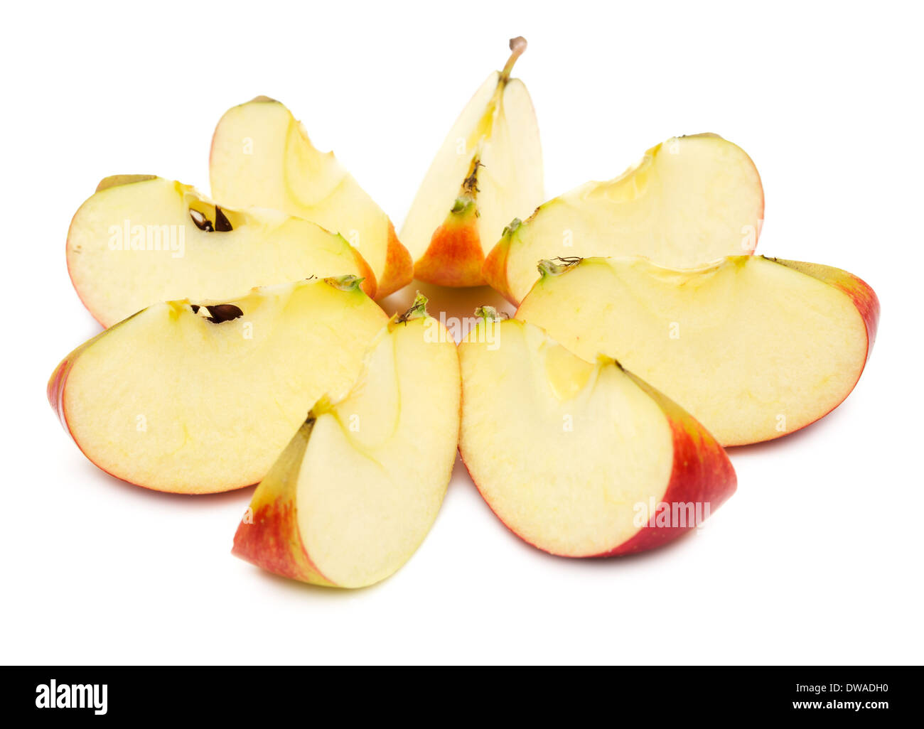 Sliced red apple, showing core. Isolated on white background. - Stock Image