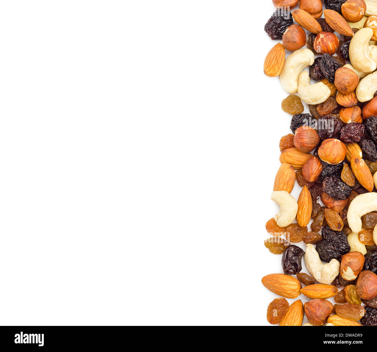 Mixed nuts and dry fruits background. Clipping path. Stock Photo