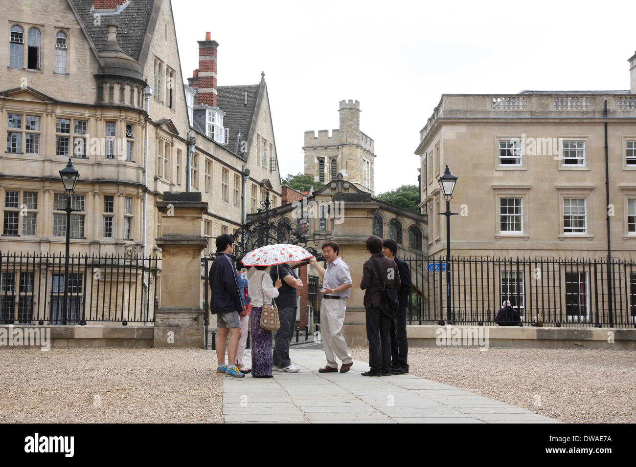 Tourists in Oxford viewing the colleges. - Stock Image