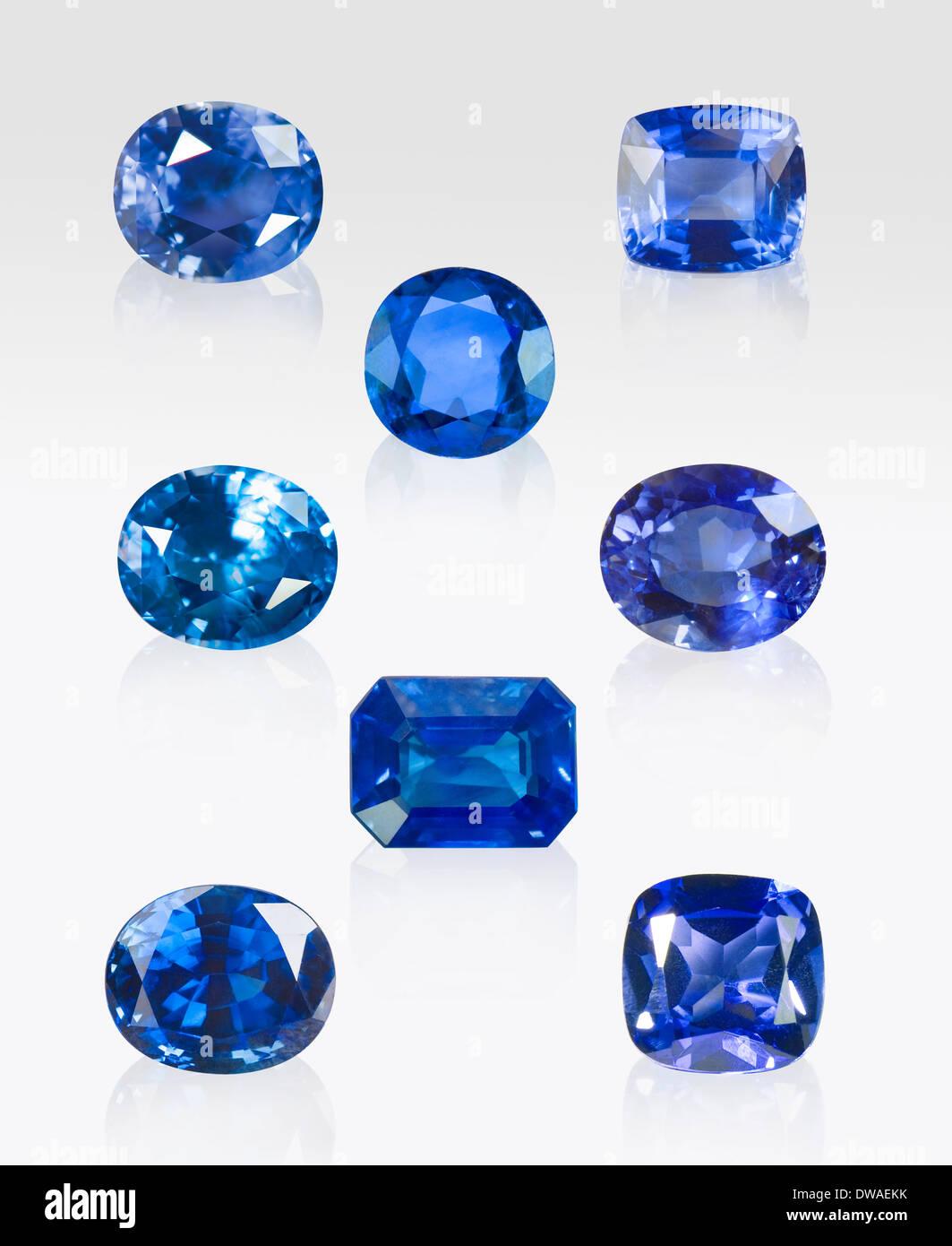 Blue Sapphires from around the world: T-L; Thailand, T-R; Sri Lanka, T-M; Lanka, M-L; Australia, M-R; Madagascar; B-M; Lanka, B-L; Aust, B-R; Tanzania - Stock Image