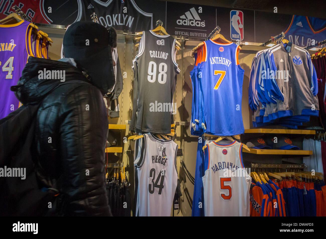 1a5717d4d82 Jason Collins' number 98 Brooklyn Nets basketball jersey is seen amongst  other players' uniforms
