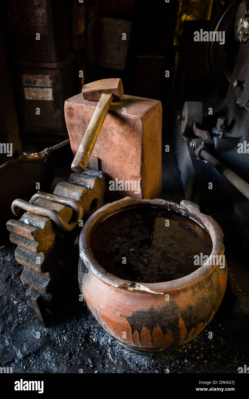 A water container is used for quenching the steel of the sword blade while this is being forged and folded. - Stock Image