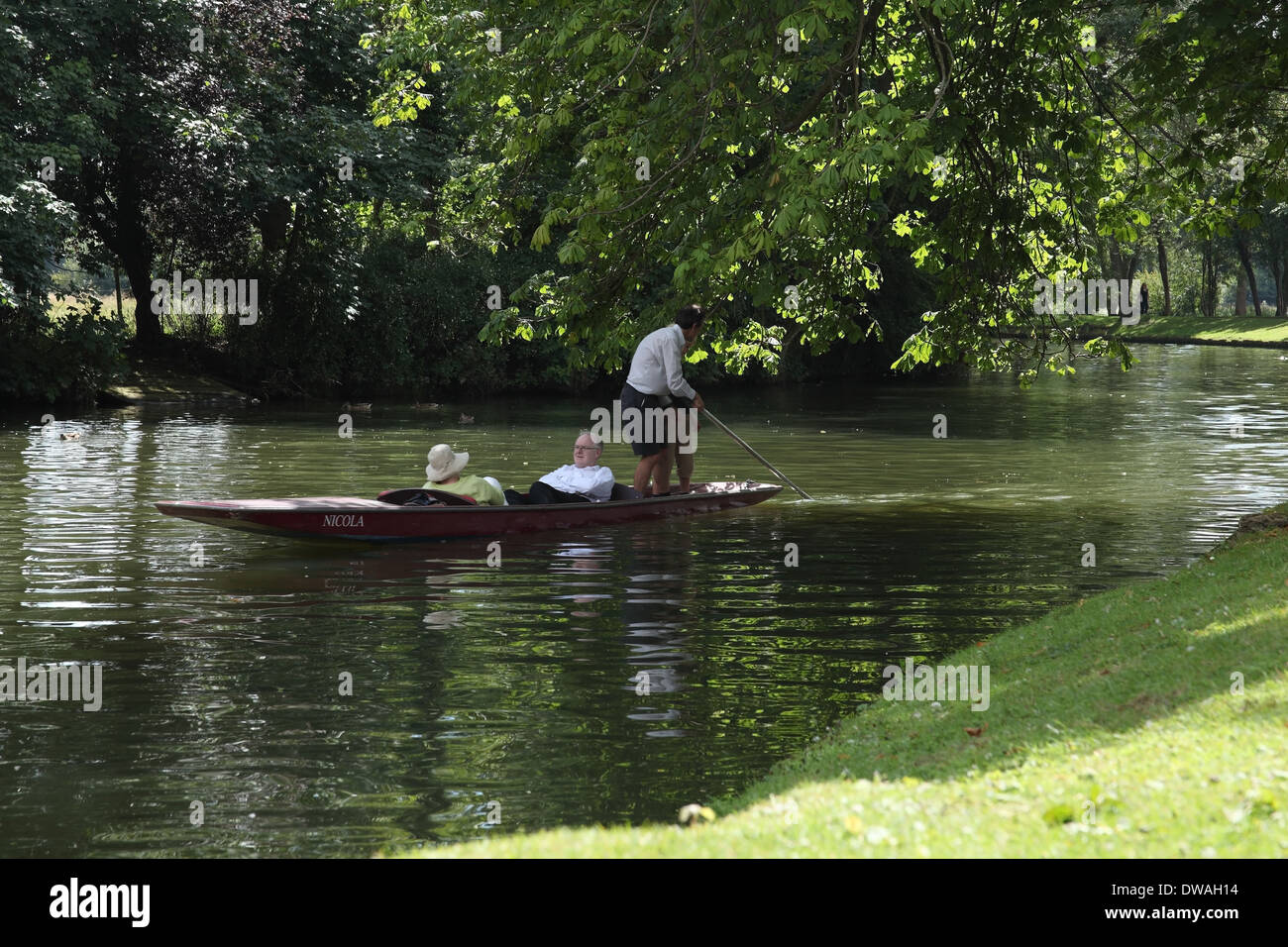 A family punting on the Thames in Oxford UK. - Stock Image