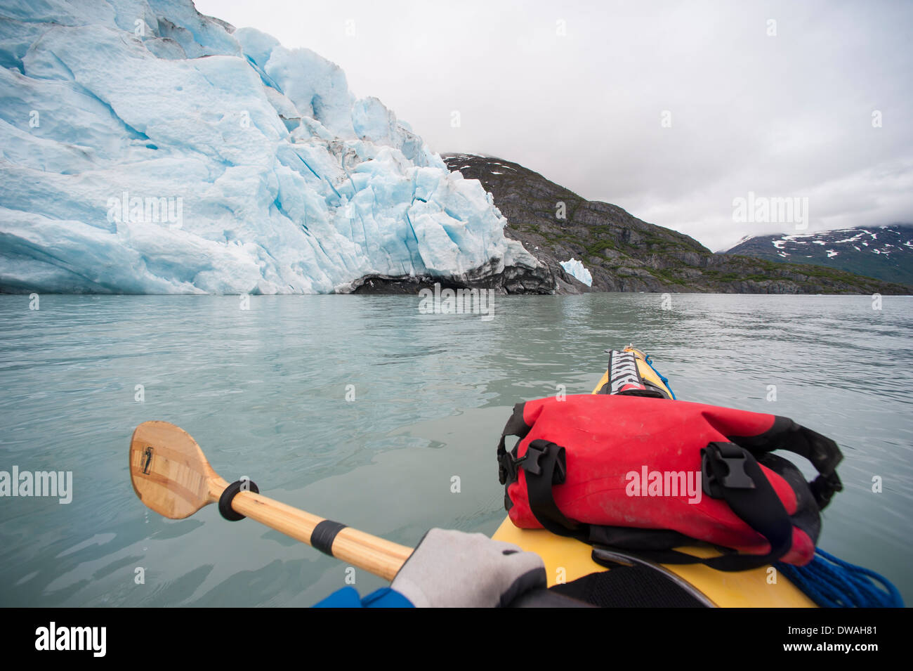 First person viewpoint photo of bow of sea kayak on Portage Lake, near Portage Glacier, Southcentral, Alaska - Stock Image