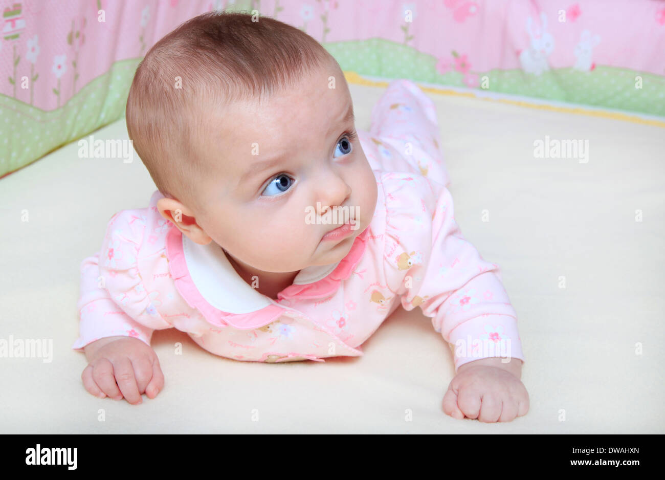 Baby girl toddler in crib - Stock Image