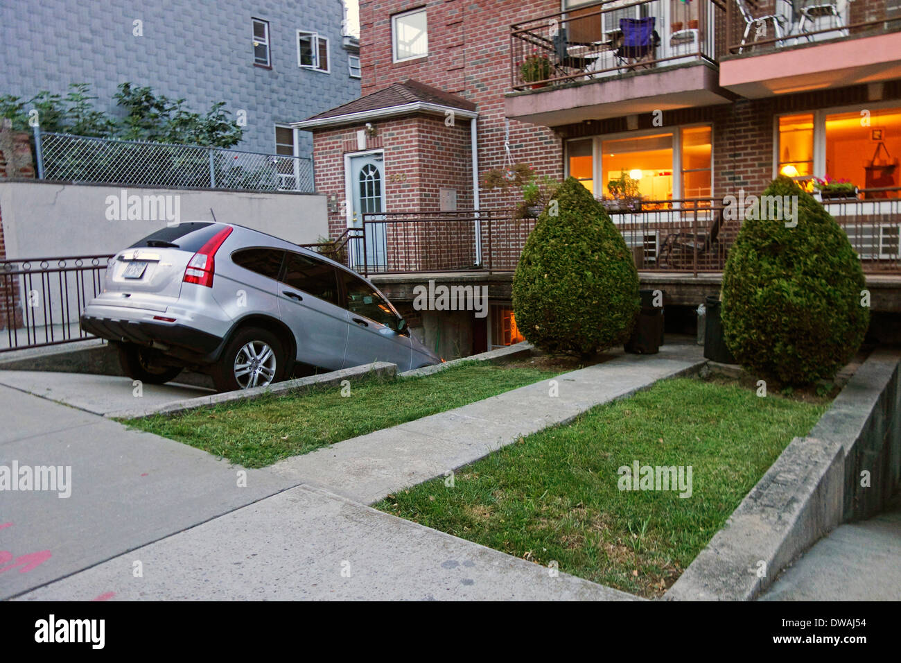 car parked in steep driveway in brooklyn ny stock photo