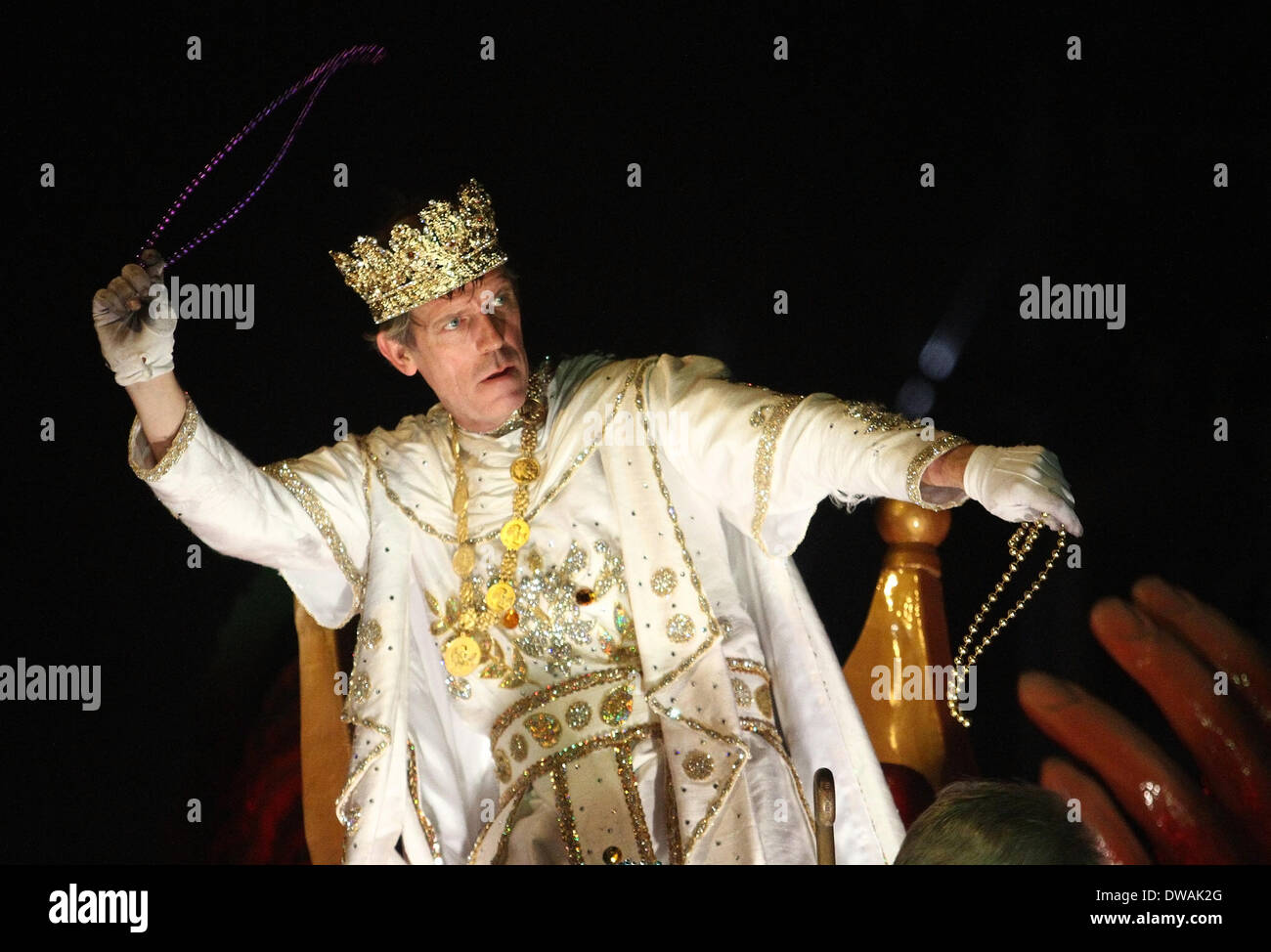 New Orleans, LOUISIANA, USA. 2nd Mar, 2014. Actor Hugh Laurie throws beads out to the crowd as Bacchus 2014 during Stock Photo