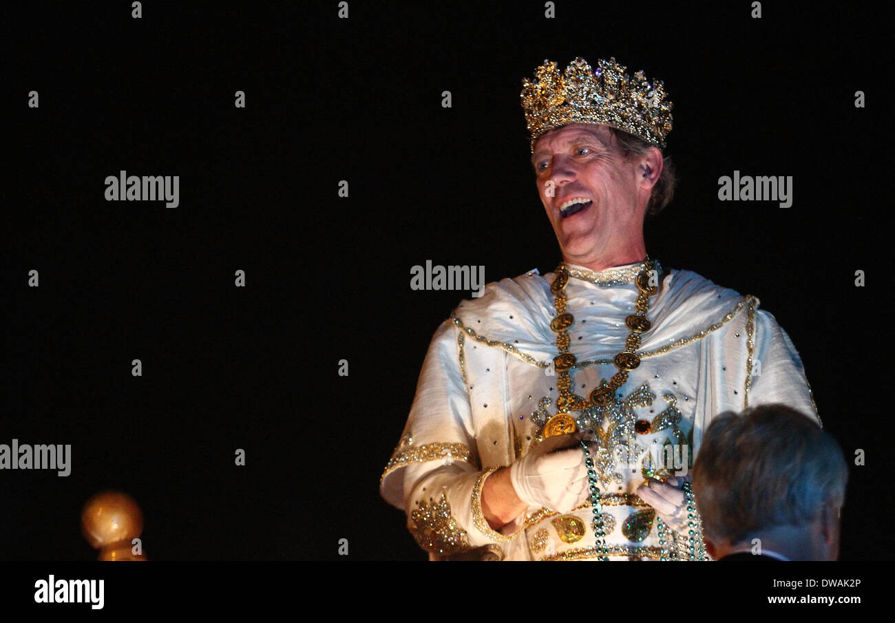 New Orleans, LOUISIANA, USA. 2nd Mar, 2014. Actor Hugh Laurie smiles at the crowd as Bacchus 2014 during the Krewe Stock Photo