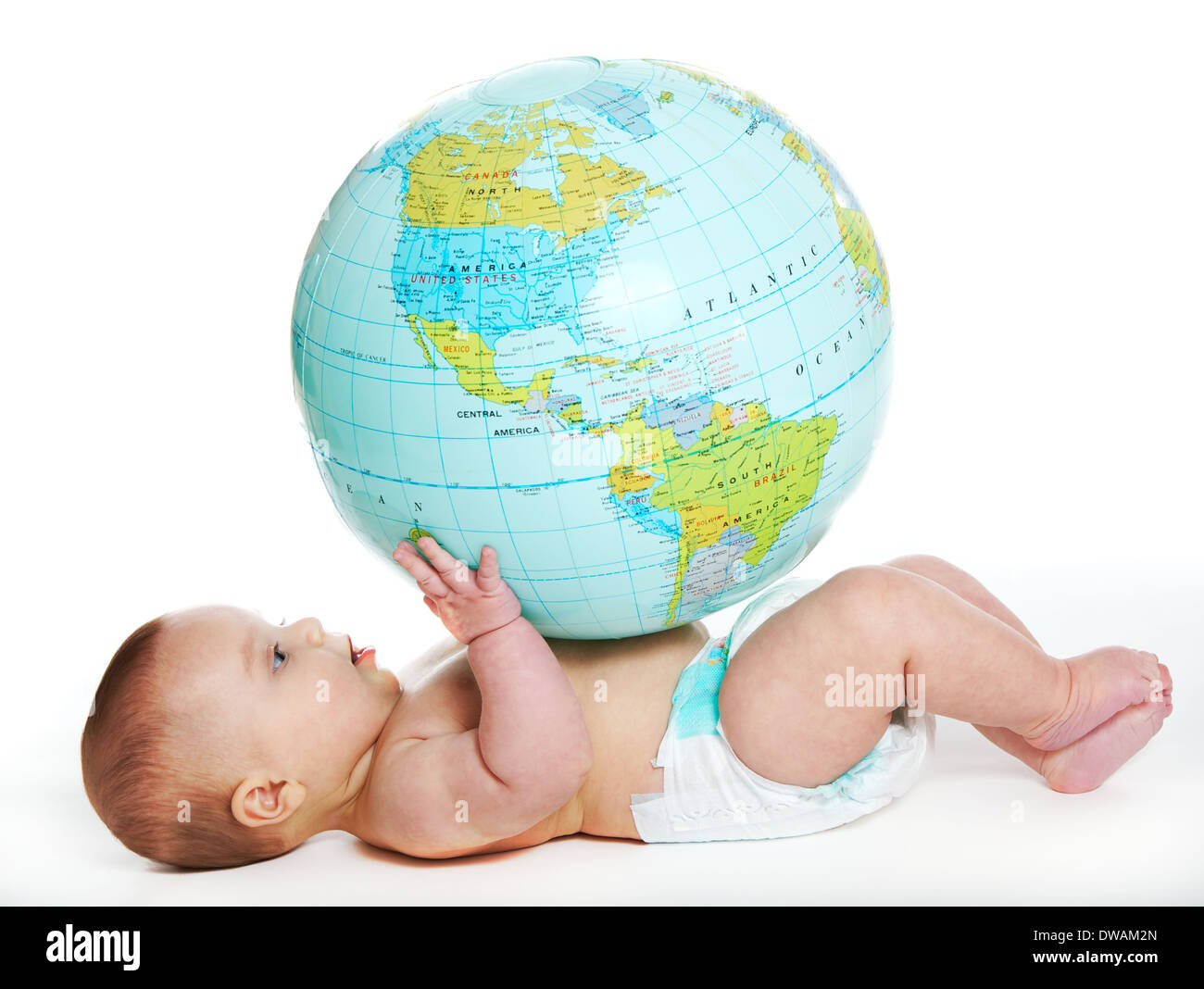 Baby girl discover the earth - Stock Image