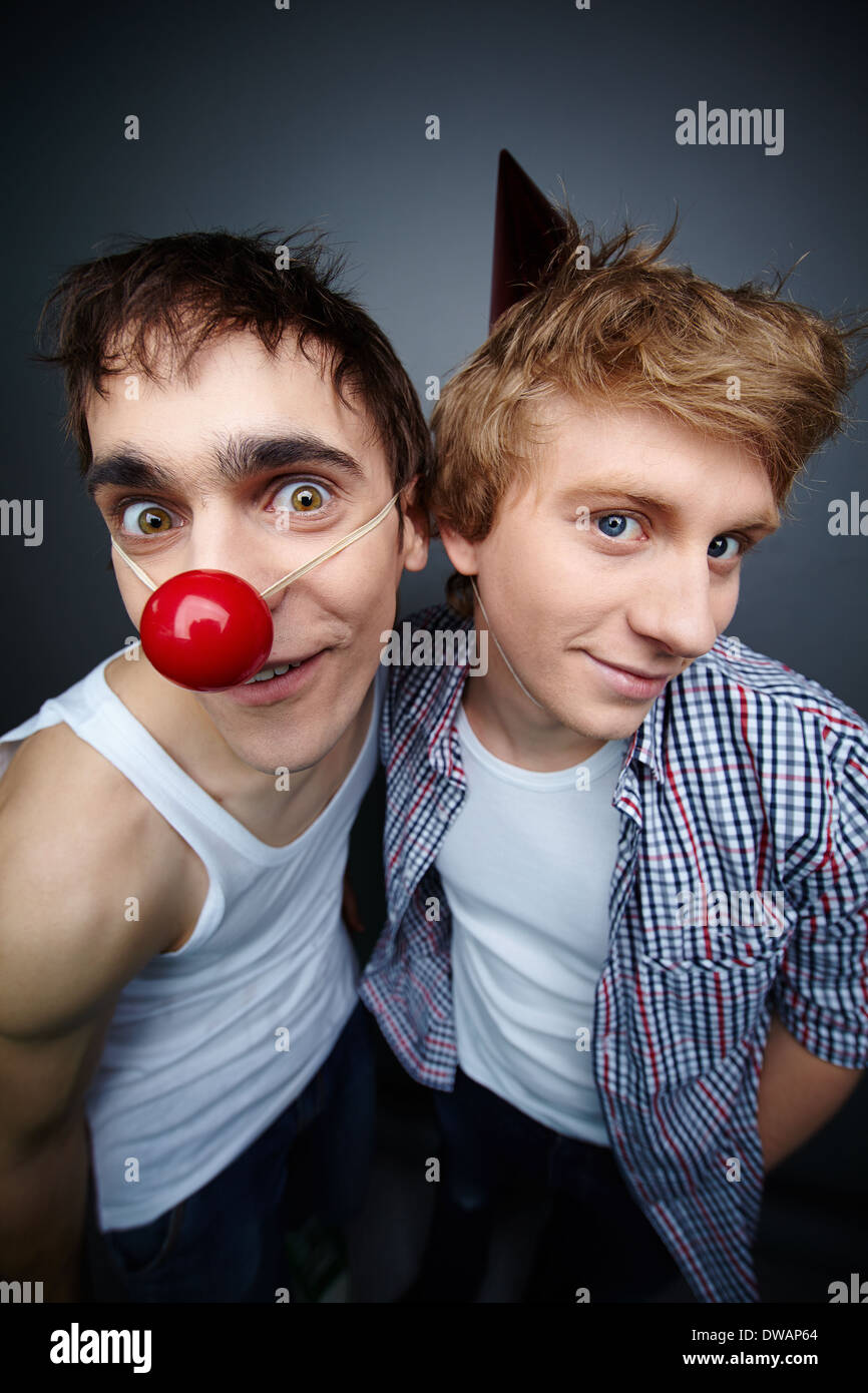 two guys having fun making faces at camera on fool s day stock photo