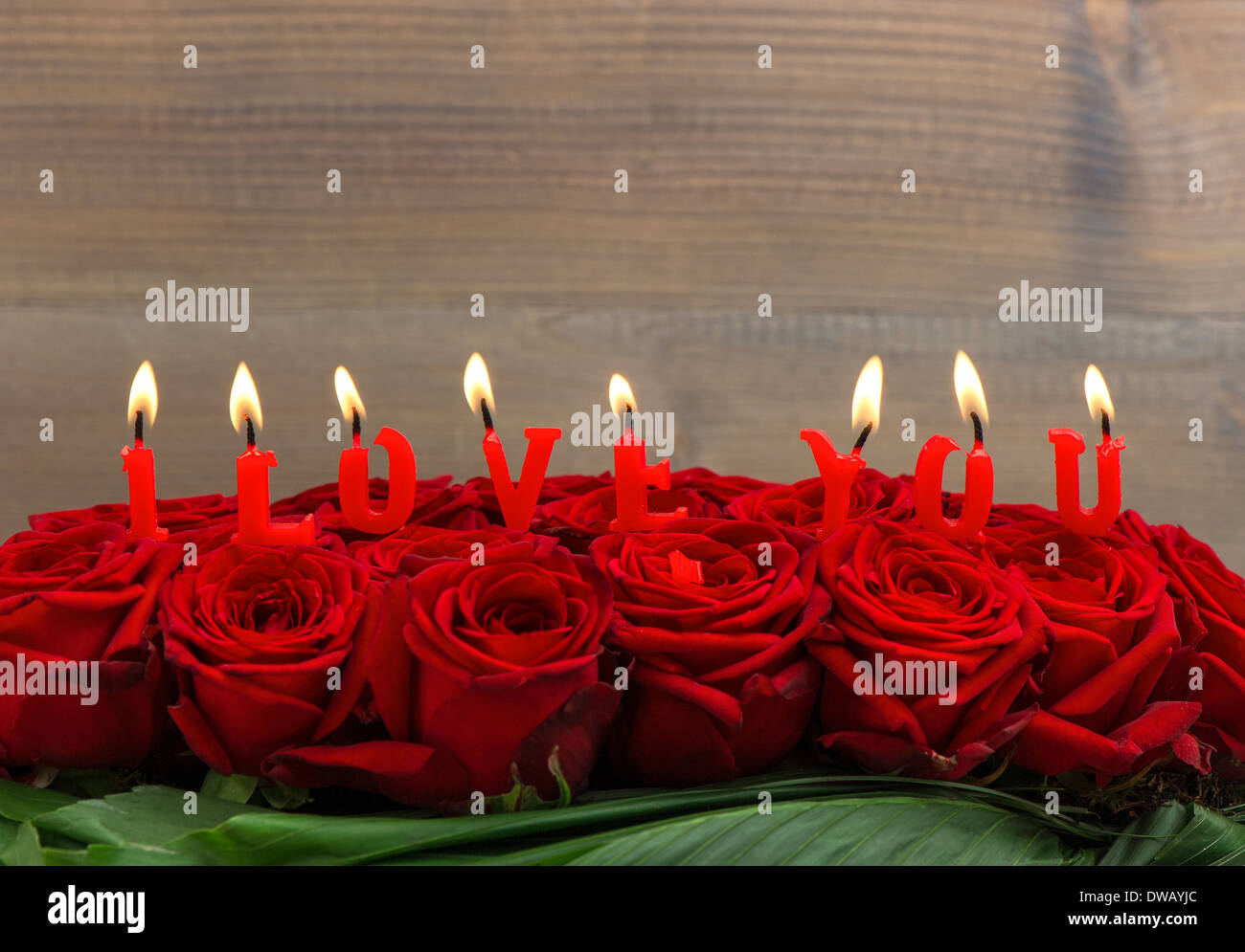 Red Roses And Burning Candles Making I Love You Flower Arrangement Stock Photo Alamy