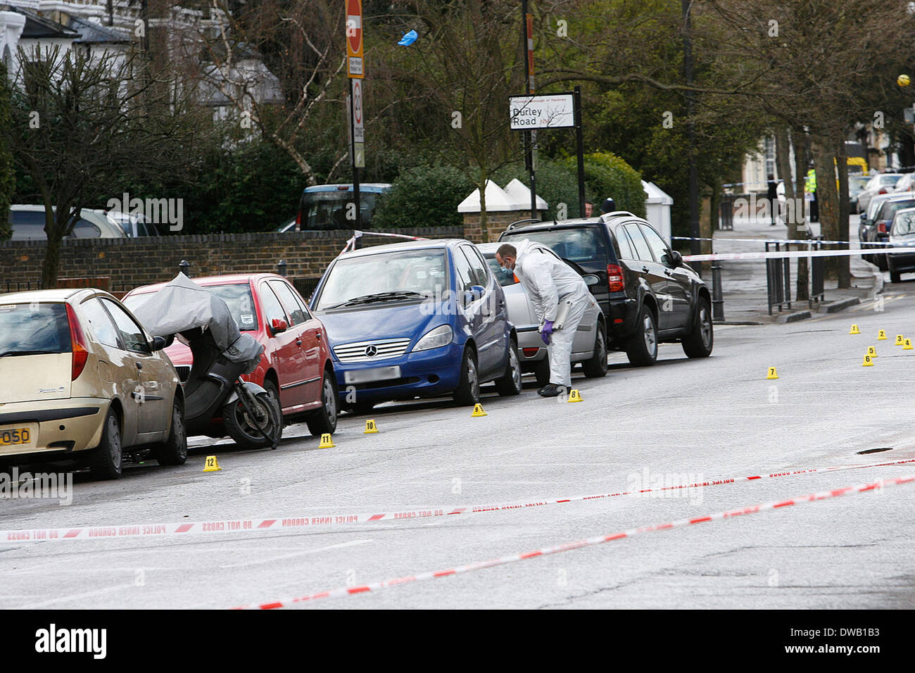 Forensic team at the scene of a 17 year old victim stabbed to death Near Mannor Park North London - Stock Image