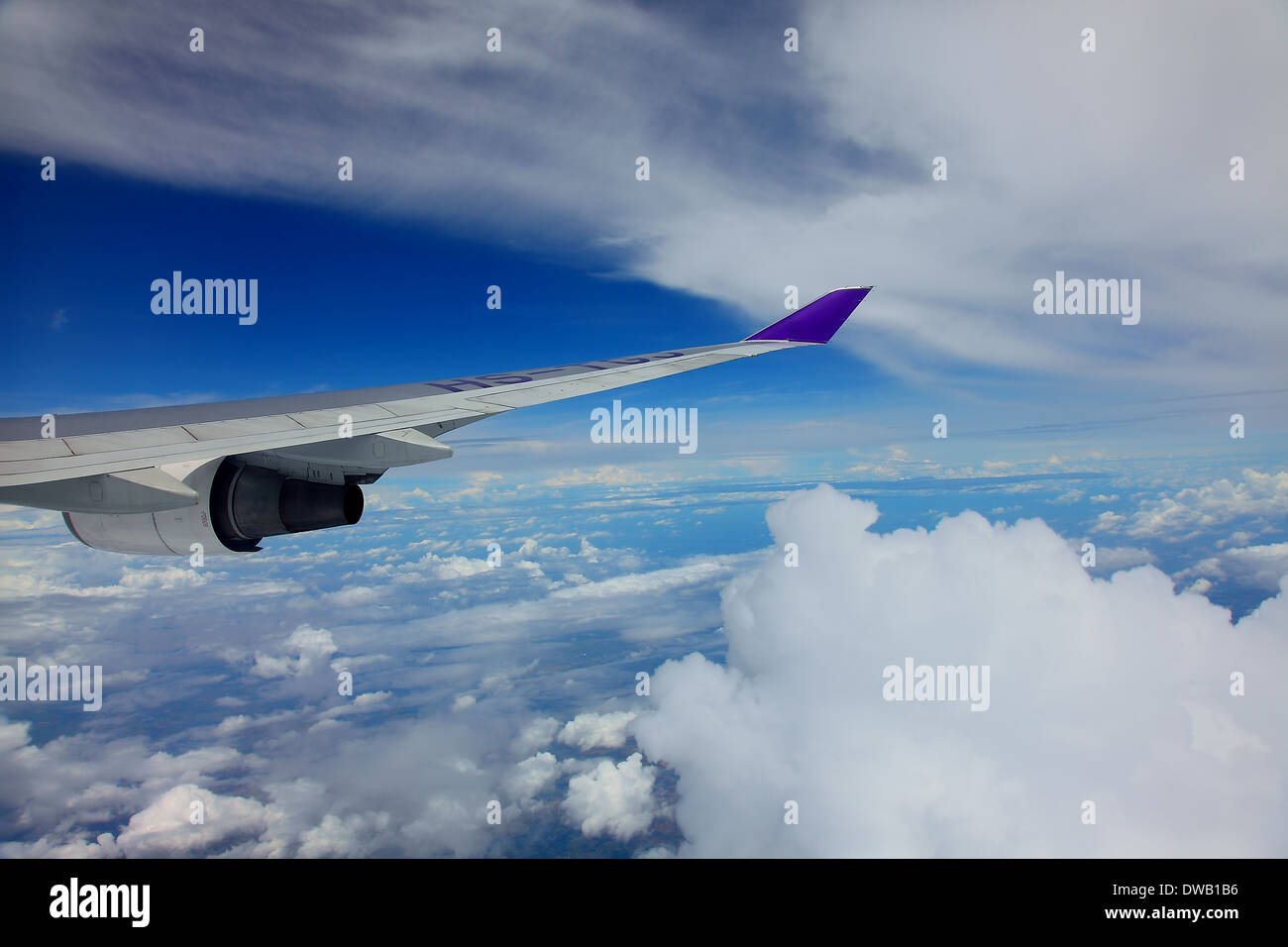Jet plane engine wing sky clouds - Stock Image