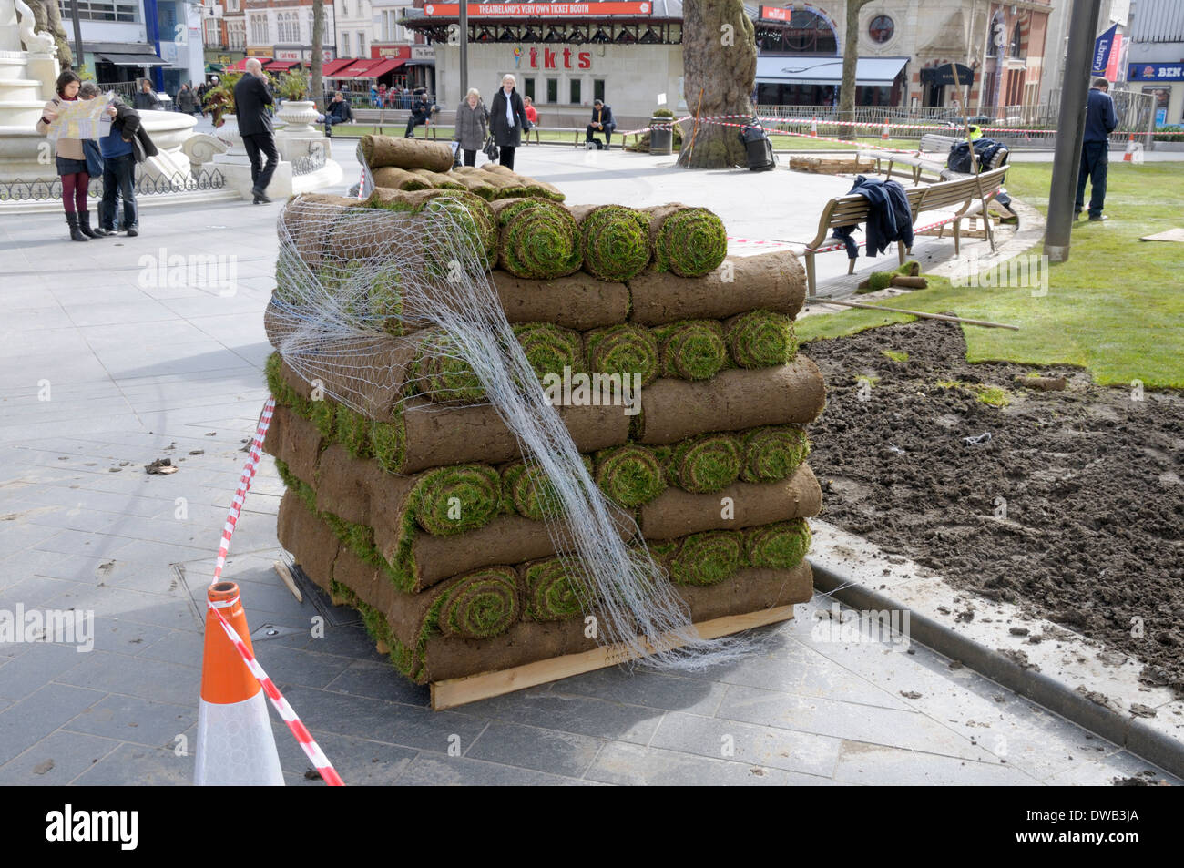 London, England, UK. Laying new turf in Leicester Square (March 2014) - Stock Image