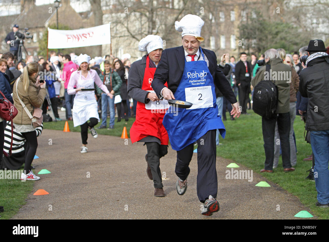 London,UK,4th March 2014,Fierce competition in the Parliamentary Pancake Rac Credit: Keith Larby/Alamy Live News - Stock Image