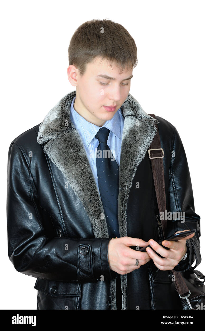 Young man reading sms message on importance of smartphone - Stock Image