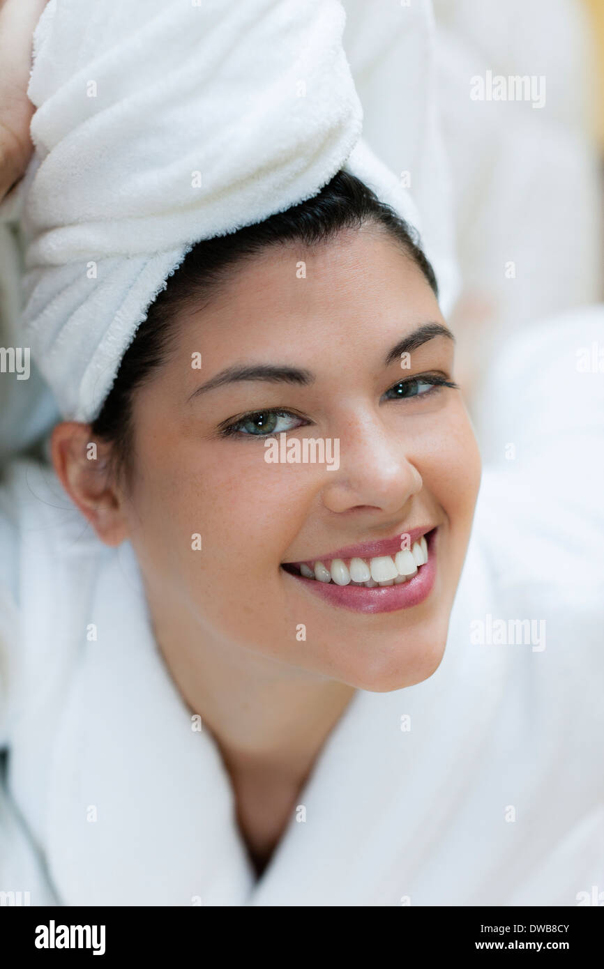 Young woman in bathrobe and turban - Stock Image