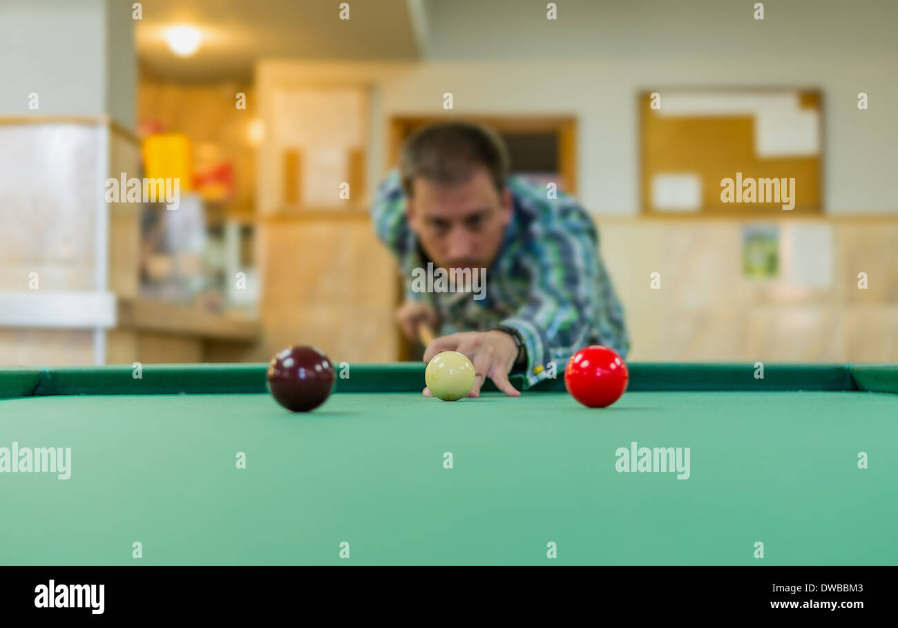 Young man playing snooker. Billiard - Stock Image