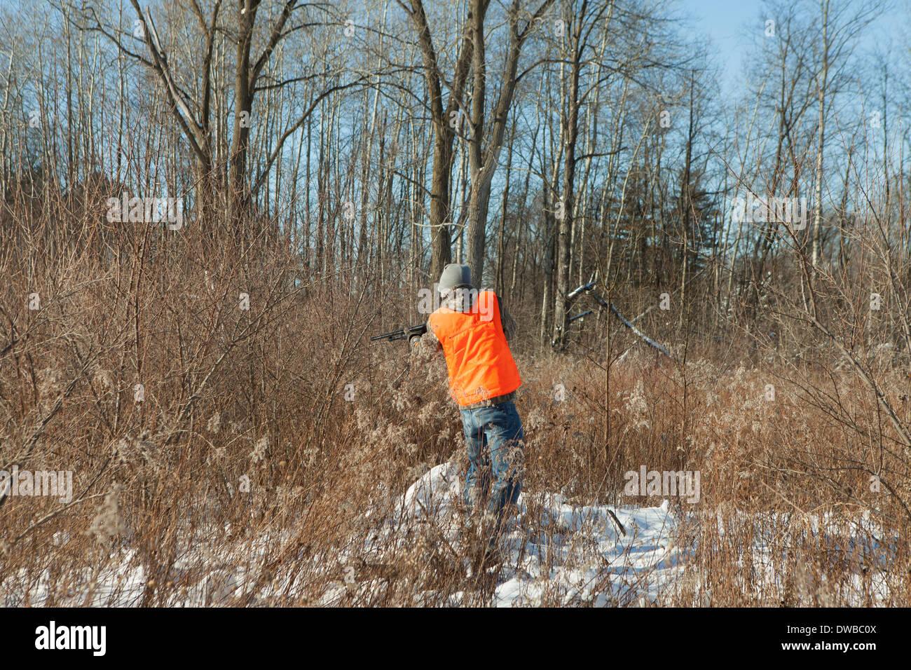 Teenage boy shooting wildlife in Petersburg State Game Area, Michigan, USA - Stock Image