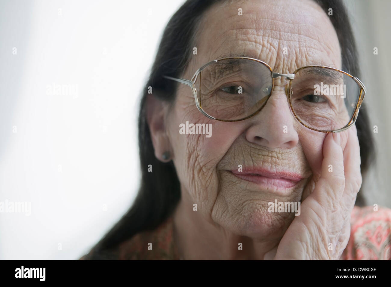 Senior woman wearing glasses - Stock Image