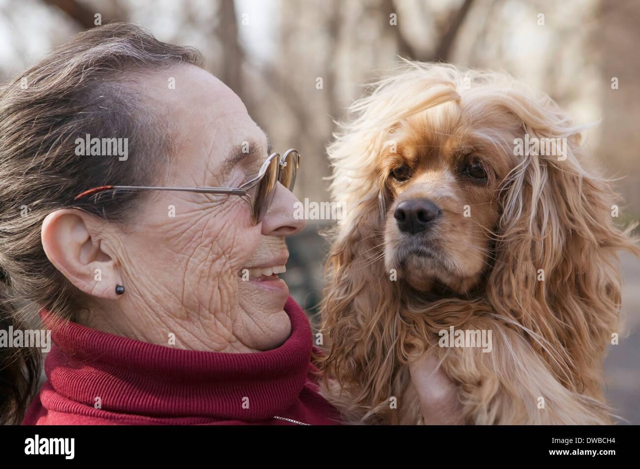 Senior woman with dog - Stock Image