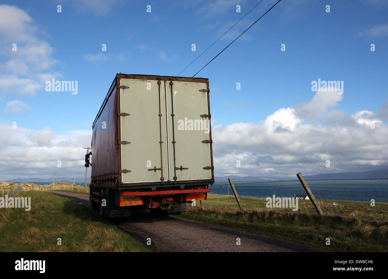 Huge lorry filling a single track road in the Inner Hebrides of Scotland - Stock Image