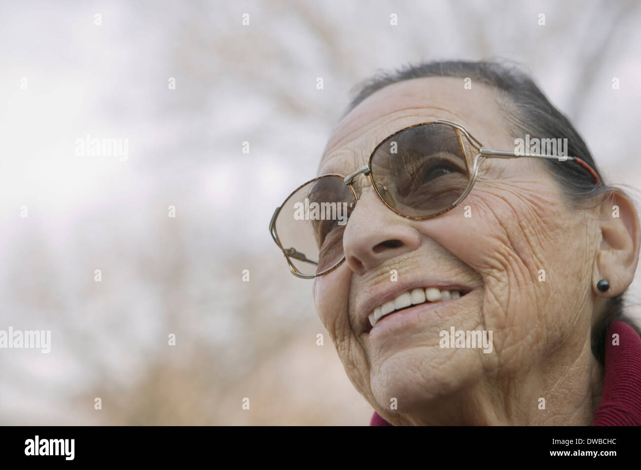 Portrait of senior woman wearing eyeglasses - Stock Image